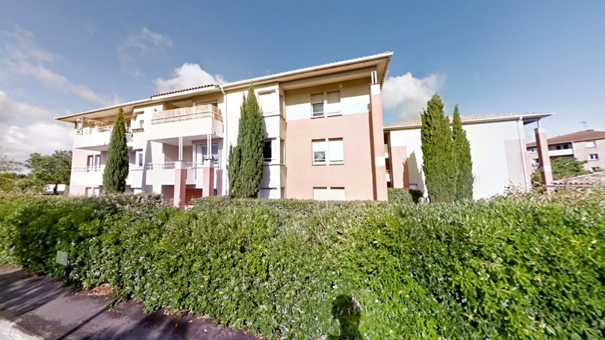 programme neuf toulouse lalande - Un immeuble construit sur 3 étages et situé dans une impasse résidentielle