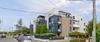 programme immobilier neuf saint-martin-du-touch - Immeuble avec persiennes métalliques
