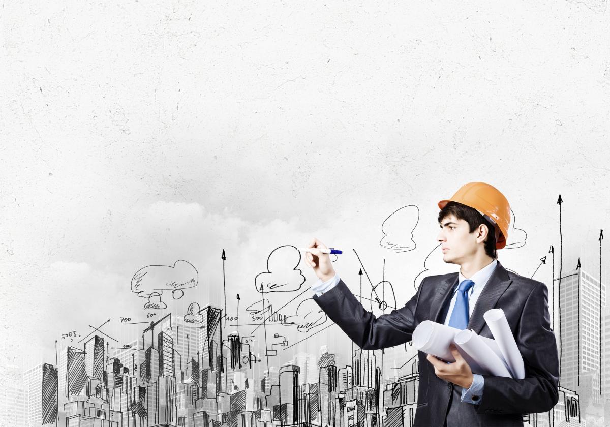 Dessine-moi Toulouse - Ingénieur en construction immobilière qui dessine les plans d'une ville.