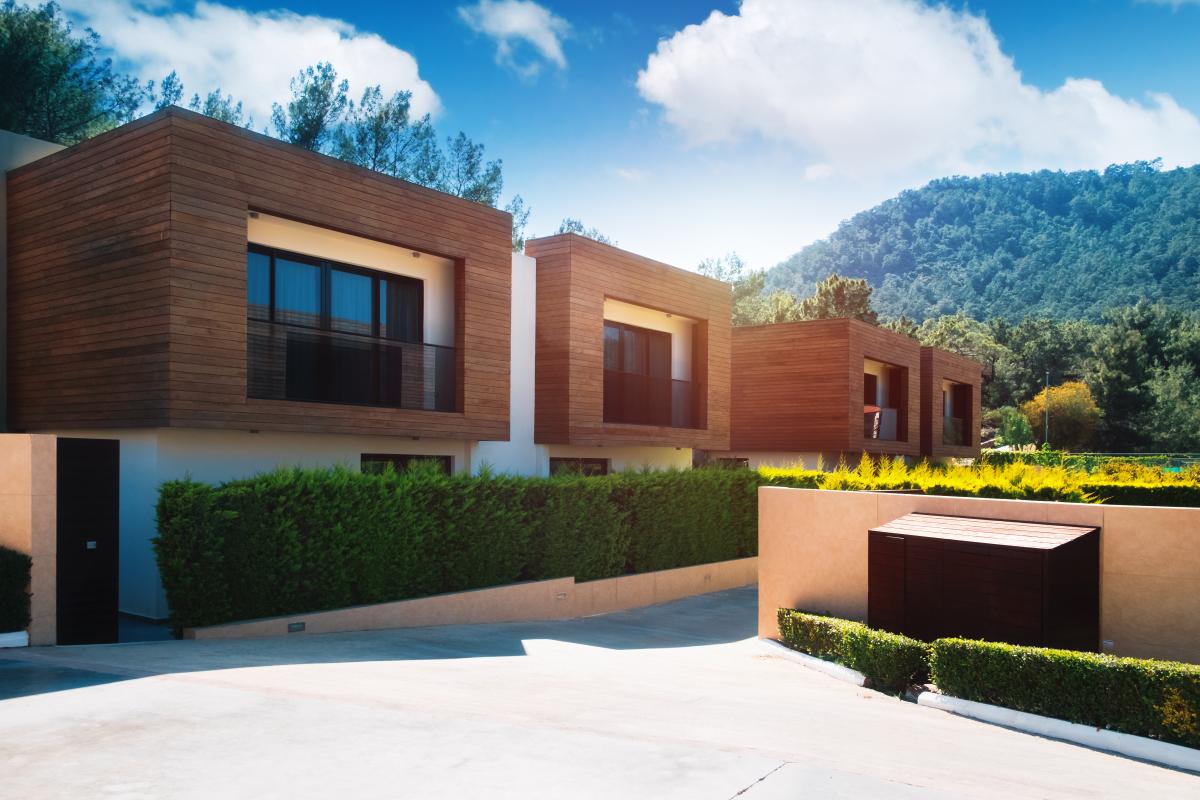 """""""Maisons en bois écologiques avec haies vertes"""""""