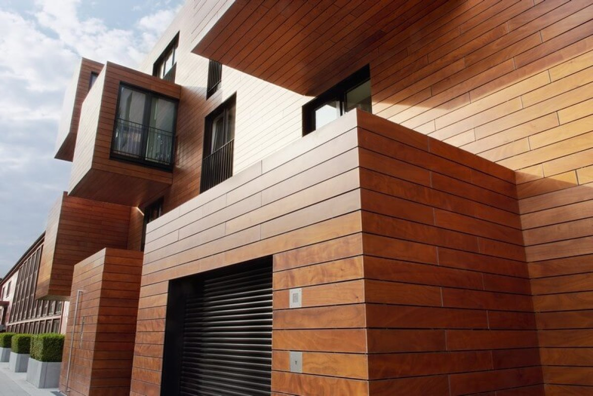 Immeuble en bois avec jeux de volumes et baies vitrées