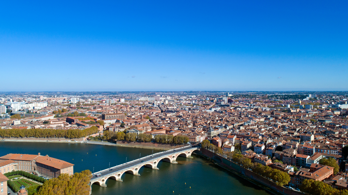 acheter appartement neuf Toulouse - Une vue aérienne de la ville de Toulouse et de la Garonne
