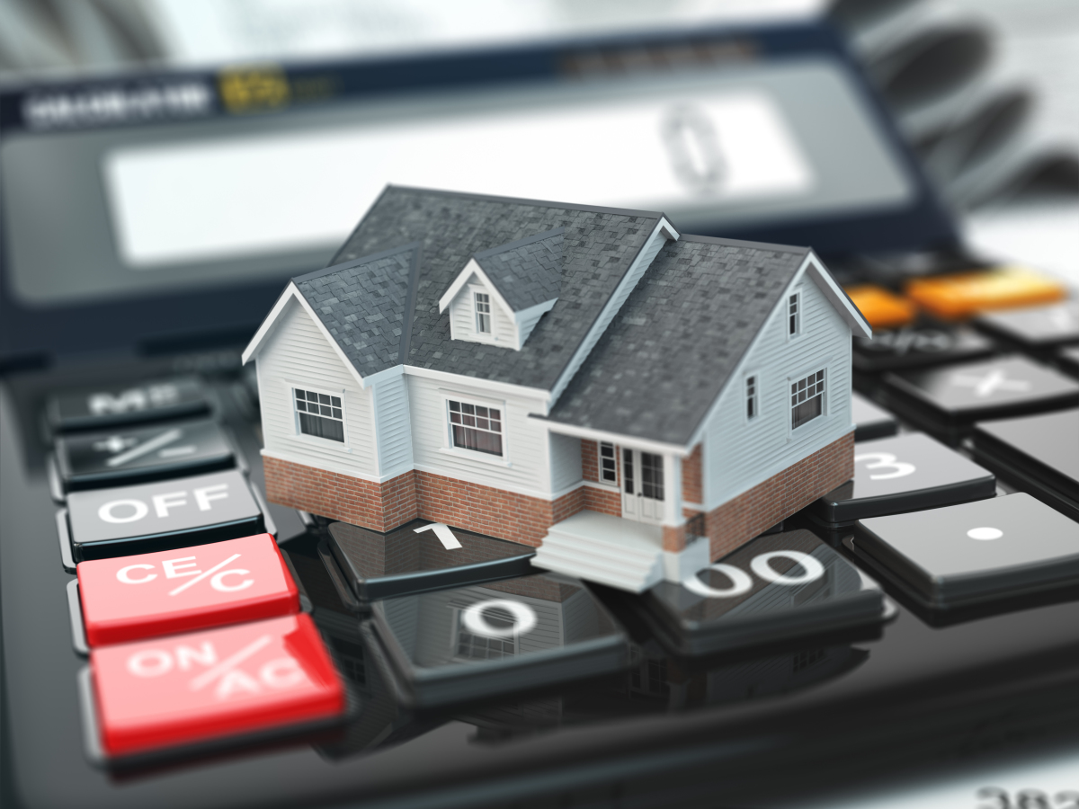 acheter appartement neuf Toulouse - Une petite maison sur une calculatrice