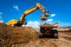 Enova – Pelle mécanique et camion benne sur un chantier