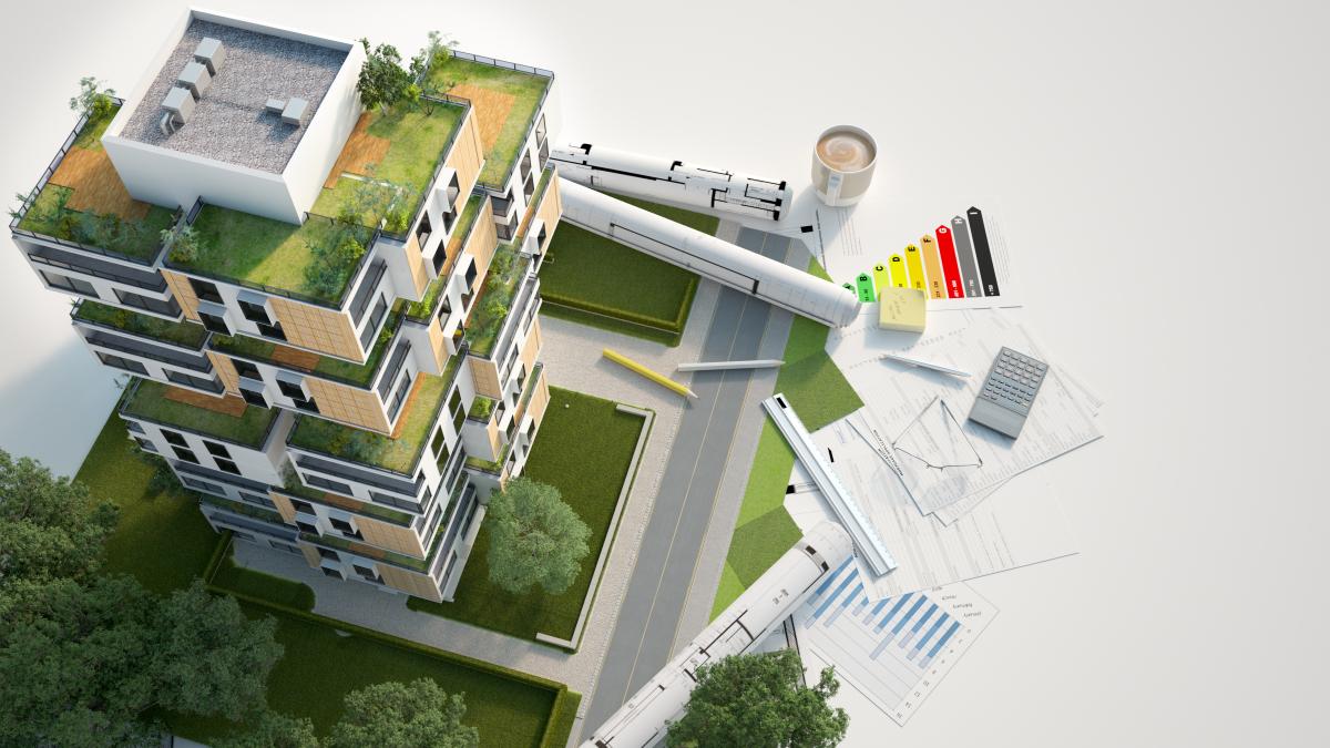 Maquette d'un bâtiment basse consommation avec étiquette énergétique